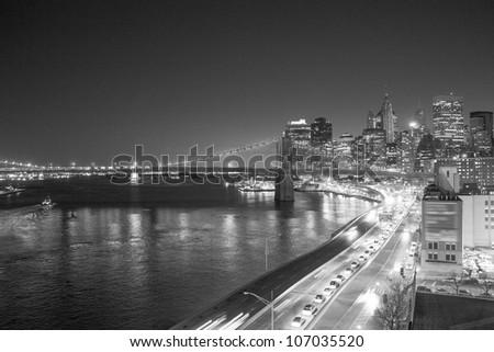 Bridge of New York City at Sunset, Manhattan Skyline - stock photo