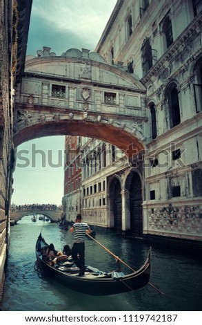 Bridge of Sighs as the famous landmark and gondola in Venice Italy.