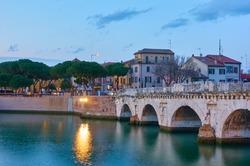 Bridge of Tiberius (Ponte di Tiberio) in Rimini at dusk, Emilia-Romagna, Italy
