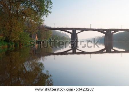 Bridge on the river at sunrise