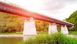 bridge over a mountain river on concrete pillars
