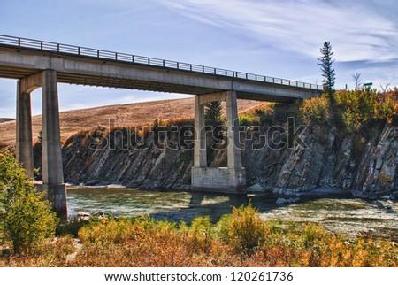 Bridge over a river in the prairies, Alberta Canada
