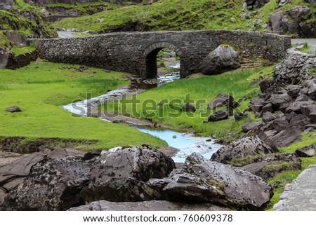 Bridge over a rocky meadoq
