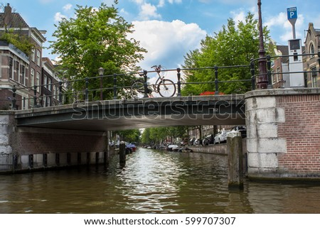 Bridge over canal in Amsterdam, Holland #599707307