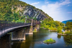 Bridge over the Potomac River and view of Maryland Heights, in Harper's Ferry, West Virginia.