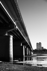 bridge over the river. black and white urban landscape of reservoir and road bridge