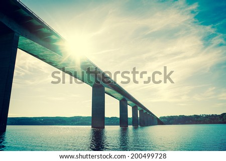 bridge over water with sunshine