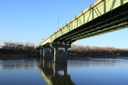 Bridge reflection in Missouri River at Berkley Riverfront in Kansas City, Missouri