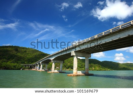Bridge Road on the sea, blue sky background