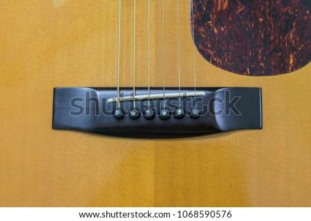 bridge saddle of guitar close-up