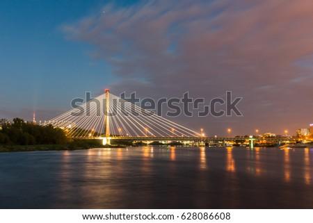 Bridge Swietokrzyski over the Vistula river in Warsaw, Poland #628086608
