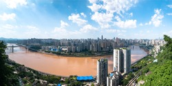 Bridge Through Jialing River in the Downtown of Chongqing City and With Skyscrapers and Blue Sky Background | China