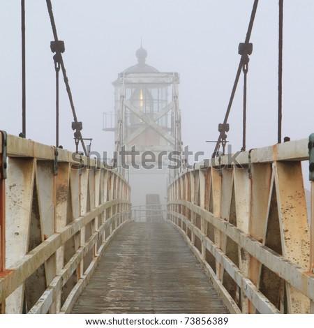 bridge to Point Bonita Lighthouse in fog, near San Francisco
