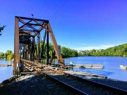 bridge water city train trestle appleton wisconsin blue sky trees nature