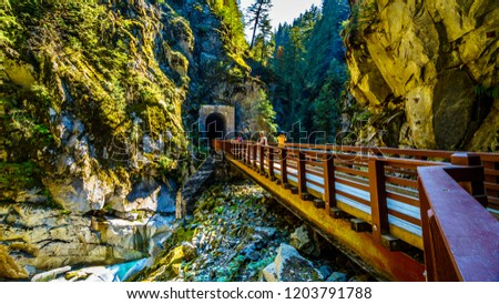Bridges connecting the Othello Tunnels that were carved through the Coquihalla Canyon for the now abandoned Kettle Valley Railway at the town of Hope, British Columbia, Canada #1203791788