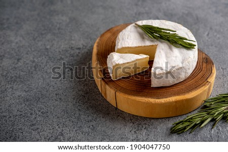 Brie cheese. Camembert cheese. Brie cheese or Camembert cheese  on a wooden board.