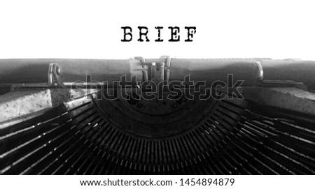 Brief typed words on a Vintage Typewriter #1454894879