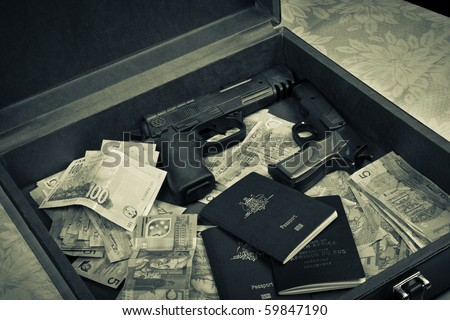Briefcase Filled With Money, Guns And Passport Stock Photo ...