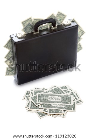 briefcase stuffed with dollar bills isolated on white