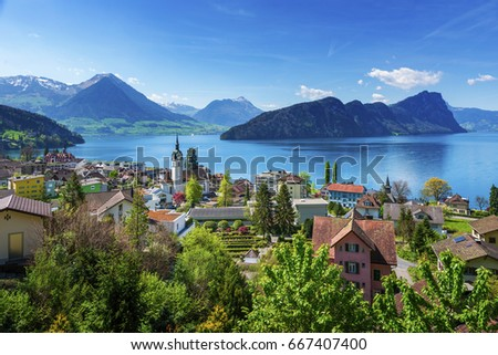 Brienz town on Lake Brienz by Interlaken, Switzerland, with snow covered Alps mountains in background