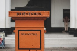 brievenbus means mailbox and buslichting means collect,  an old dutch mailbox
