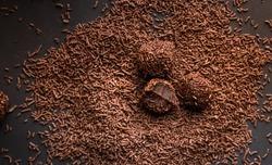 Brigadeiro (Brigadier) a Brazilian chocolate candy. Traditional Brazilian handmade chocolate sweet on dark background
