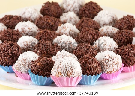 Brigadeiros (Brazilian Sweets) And Coconut Balls On A White Plate ...