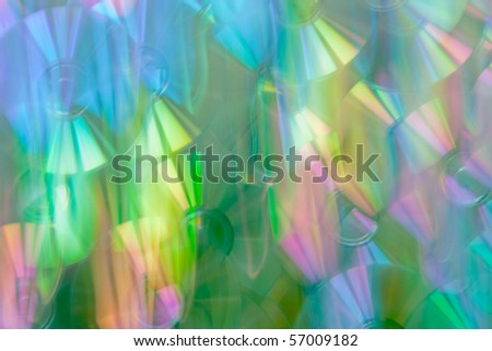 Bright abstract background. CD. Light dispersion. All colors of a rainbow.