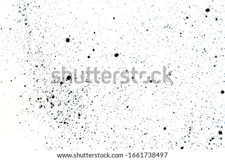Photo of  bright abstract background splattered with drops of paint