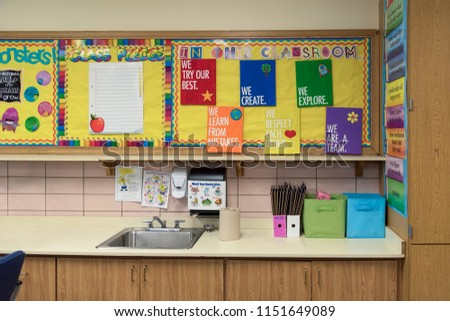 Bright and colorful bulletin boards above the sink in an elementary school classroom