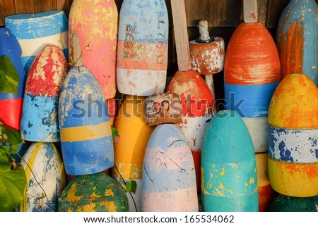 Bright and colorful lobster floats and lobster buoys in a small new england fishing village