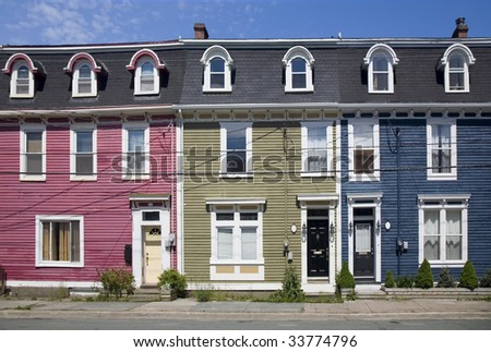 Bright and colorful yet typical unique old housing style in the old part of downtown St. John's, Newfoundland, Canada.