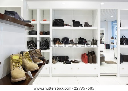 bright and fashionable interior of shoe store in modern mall
