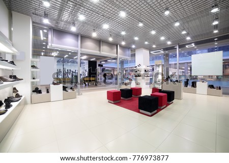 Shutterstock bright and fashionable interior of shoe store in modern mall