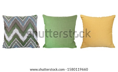 bright and fresh colorful pillows isolated in white background. front view of zigzag green pattern pillow ,green pillow and yellow pillow on white background.