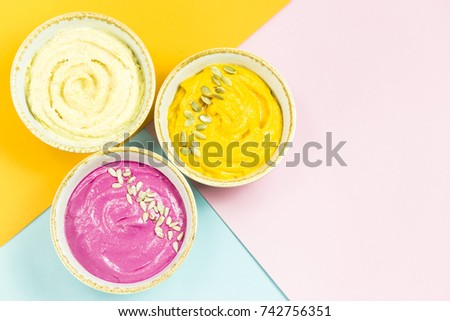 bright appetizers in the form of vegetable sauces and hummus of chickpeas on a combination multicolored background. Copyspace ストックフォト ©