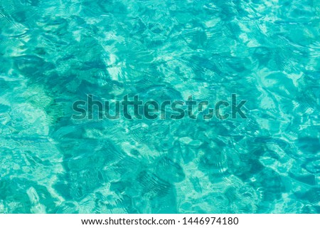 bright aquamarine and white ripple tropic sea water surface simple background photography foreshortening from above, copy space  #1446974180