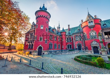 Bright autumn scene of Palace in Plawniowice. Colorful morning landscape of Upper Silesia, Poland. Traveling concept background.