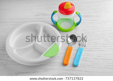 Bright baby dishware on table #737137822