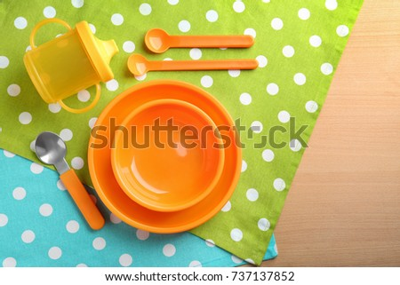 Bright baby dishware on table #737137852
