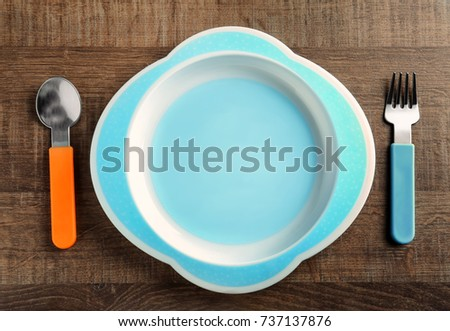 Bright baby dishware on table #737137876
