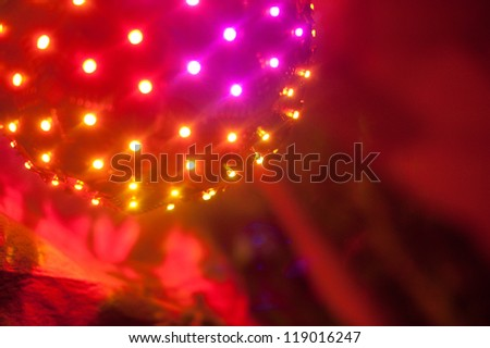 Bright ball of multicolored LED lights at a party
