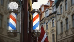 Bright barbershop pole spinning and reflecting in mirror