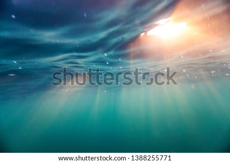Bright beams of sunlight refracting through the surface of the atlantic ocean.