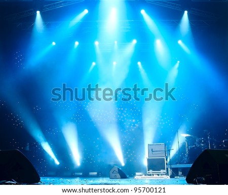 Bright beautiful rays of light on an empty stage before the concert