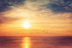 Bright beautiful sunrise or sunset at sea.