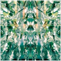 Bright beautiful symmetrical voluminous glowing optical pattern, kaleidoscope, emerald color