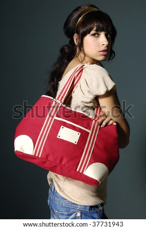 bright beautiful young woman with fashion handbag