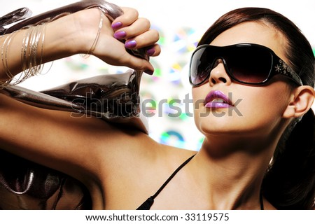 bright beautiful young woman with fashion sunglasses and handbag