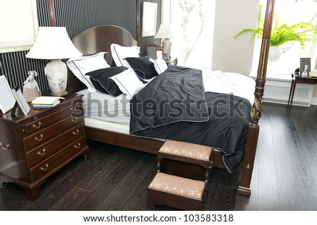 Bright bedroom with a queen size bed and cupboard